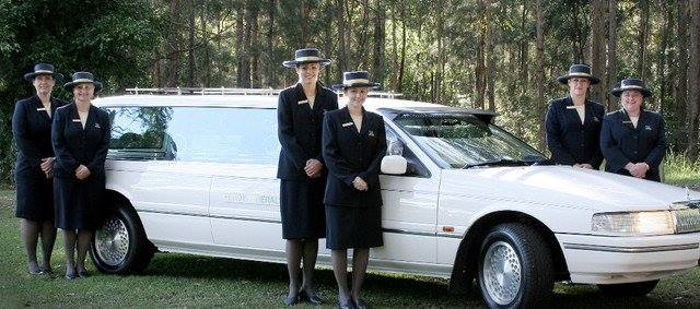 Lady Funerals standing beside hearse